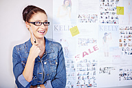 Portrait of female creative professional beside white board - ZEF001519