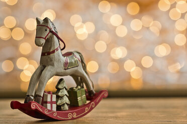 Christmas rocking horse in front of points of light - MELF000033