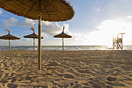Spain, Baleares, Mallorca, view to empty beach with beach umbrellas and attendant's tower - MSF004327