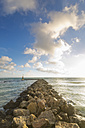 Spain, Baleares, Mallorca, view to horizon with breakwater at the foreground - MSF004322
