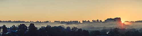 Germany, Bavaria, Burghausen, View to Old town and Castle complex at sunrise, Panorama - OPF000033