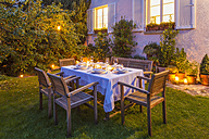 Autumnal laid table in garden in the evening - WDF002733