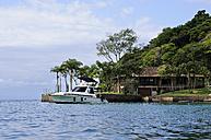 Brazil, Rio de Janeiro State, Paraty, motor yacht at mooring area - FLK000522