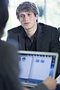 Young businessman talking to colleague - ZEF002145