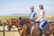 Young couple riding on the countryside - ZEF001729