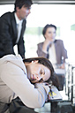 Woman sleeping during a business meeting - ZEF002175
