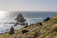United Kingdom, England, Cornwall, Land's End, Photographer photographing Armed Knight and Wols Rock Lighthouse - FRF000066