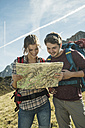 Austria, Tyrol, Tannheimer Tal, young hikers looking at map - UU002427