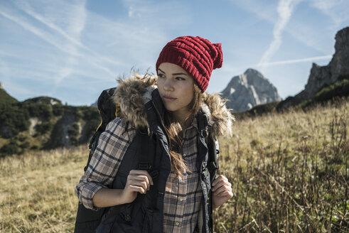 Austria, Tyrol, Tannheimer Tal, young woman on hiking trip - UUF002445