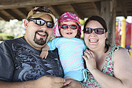 Father, mother and her little daughter wearing sunglasses - SHKF000095