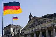 Germany, Berlin, view to upper part of Reichstag building with two German flags - PSF000664