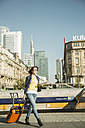 Germany, Frankfurt, young businesswoman on the move in city center - UUF002506