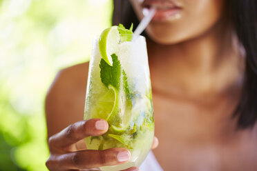 Woman drinking Mojito, partial view - ZEF001782