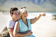 Happy young couple on the beach - ZEF002359