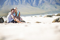 Happy young couple on the beach - ZEF002360