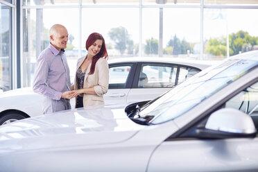 Smiling couple at car dealer - ZEF002022