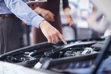 Car dealer explaining car engine - ZEF002052
