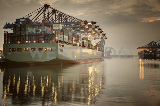 Germany, Hamburg, Container Terminal, Container ship in the evening - ROMF000025
