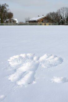 Germany, Bavaria, Chiemsee, island Frauenchiemsee, snow angel on meadow - FLKF000541