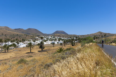 Spain, Canary Islands, Lanzarote, Maguez, Village Haria and Volcano Monte Corona in the background - AM003168