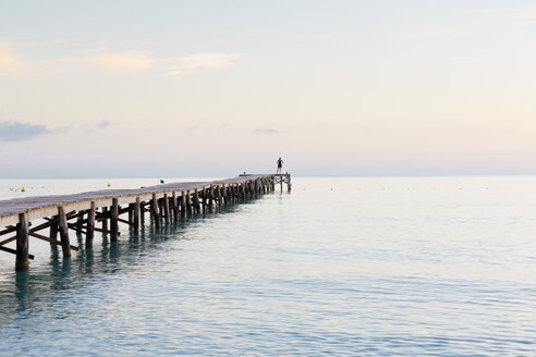 Spain, Balearic Islands, Majorca, one person standing on a jetty in the morning - MSF004337