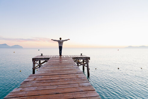 Spain, Balearic Islands, Majorca, one teenage boy standing on a jetty in the morning - MSF004343