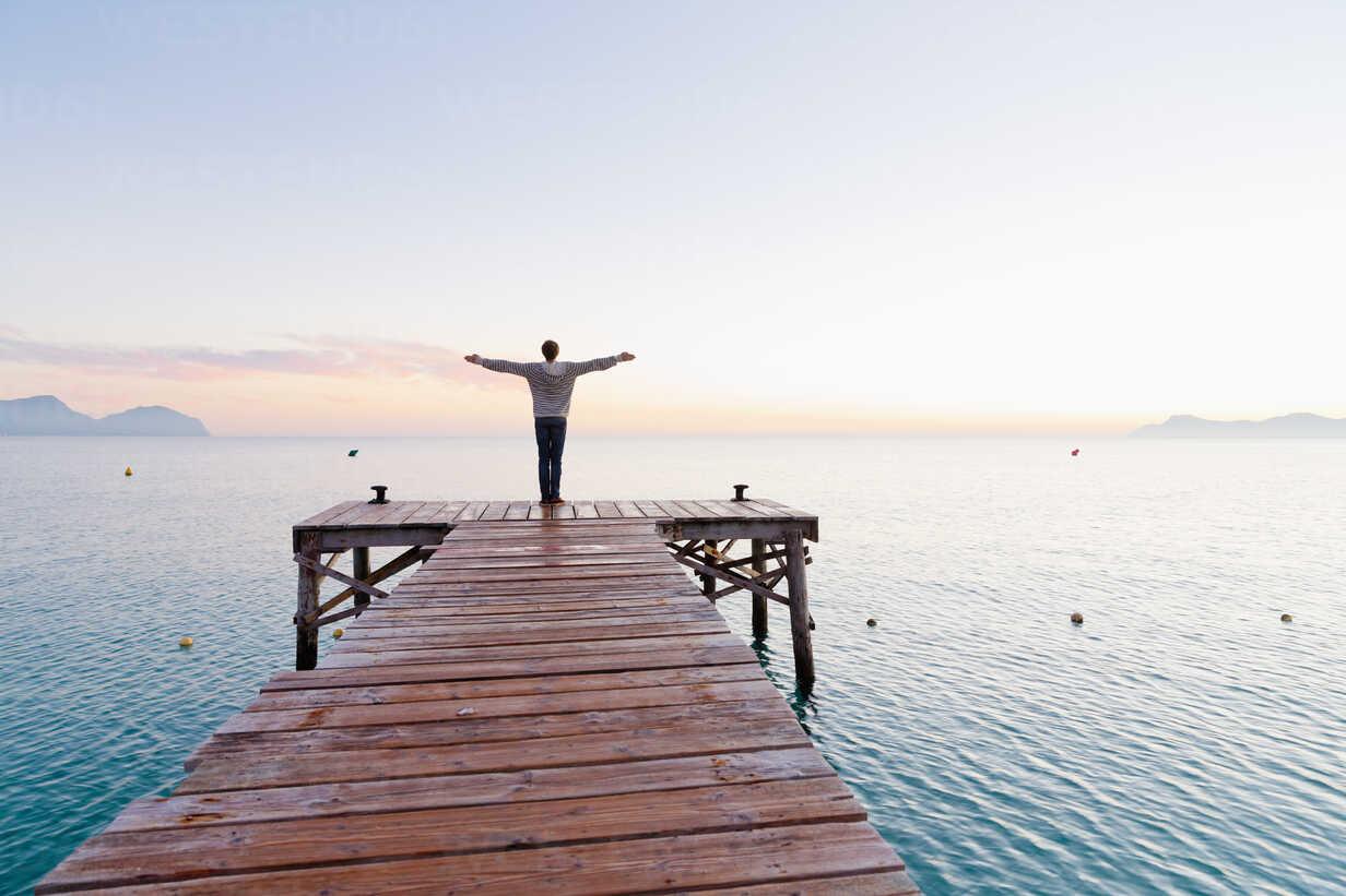 Spain, Balearic Islands, Majorca, one teenage boy standing on a jetty in the morning - MSF004343 - Mel Stuart/Westend61