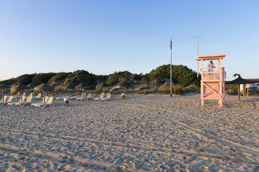 Spain, Balearic Islands, Majorca, one teenage boy standing on a lifeguard stand - MSF004353
