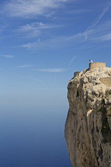 Spain, Balearic Islands, Majorca, one teenage boy looking down from a viewpoint - MSF004355