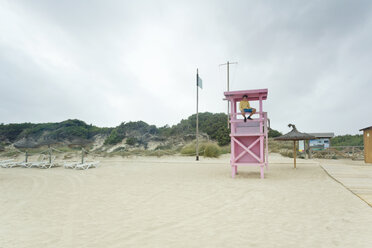 Spain, Balearic Islands, Majorca, one teenage boy sitting on a lifeguard stand - MSF004378