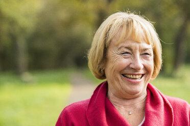 Portrait of laughing blond senior woman - UUF002582