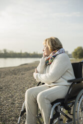 Senior woman sitting in wheelchair - UUF002606