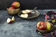 Bowls and dish of Braeburn on grey wood - MYF000679