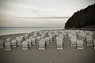 Germany, Mecklenburg-Western Pomerania, Ruegen, Sellin, hooded beach chairs at twilight - MABF000257