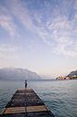 Italy, Veneto, Malcesine, Boy standing on jetty - LVF002167