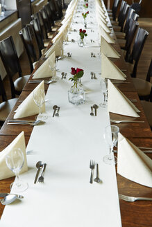 Germany, Festivly laid table for a celebration in a restaurant - RKN000172