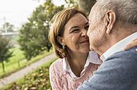 Senior man and daughter rubbing noses - UUF002663