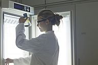 Young scientist working in a lab - SGF001034