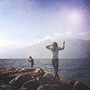 Italy, Brenzone sul Garda, two children at Lake Garda - LVF002237