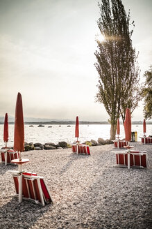 Italy, Peschiera del Garda, Lake Garda, coast at early morning - SBDF001436