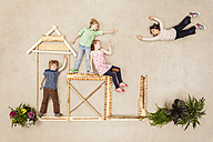 Kids playing outdoor, building wooden hut - BAEF001056
