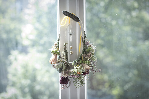 Self-made floral wreath hanging at window catch - ASCF000012