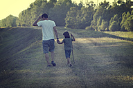 Father and daughter walking hand in hand - LVF002281