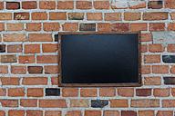 Blank blackboard hanging on brick wall - HCF000093