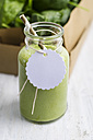 Spinach smoothie in glass with blank tag - ODF000867
