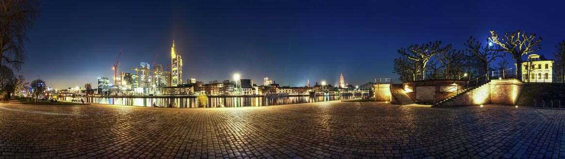 Germany, Hesse, Frankfurt, view to skyline with Main River in the foreground at night - PUF000317