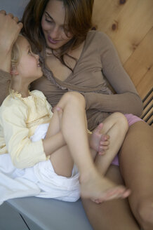 Mother and daughter relaxing in hotel spa - FSF000345