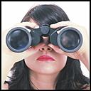 Woman looking through binoculars - HOHF001116