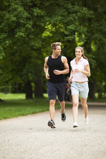 Man and woman jogging in park - CvKF000214