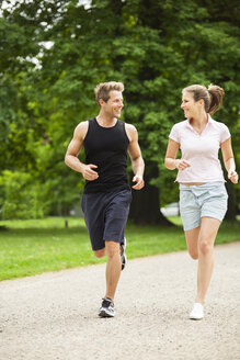 Man and woman jogging in park - CvKF000215